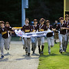 HADLEY GREEN/Staff photo<br /> Danvers National Little League all-star players run with the championship banner after winning against Amesbury in the District 15 final at the Harry Ball Field in Beverly. <br /> <br /> 07/13/2018