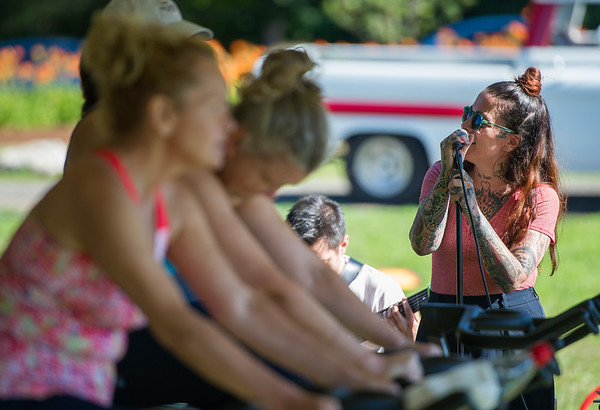 AMANDA SABGA/Staff photo<br /> <br /> Lisa Bello, of Boston sings while people warm up for a spin class during the 5th Annual Paddle for Plummer fundraiser for Plummer Youth Promise.<br /> <br /> 7/7/18