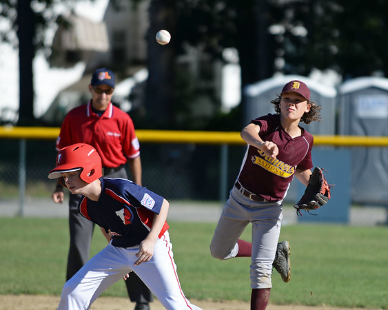 RYAN HUTTON/ Staff photo<br /> Danvers' Owen Gasinowski fires the ball over the head of Peabody West's Ty Zito on second to try and make the play at first in the bottom of the second inning of Wednesday's Little League tournament game in Andover.