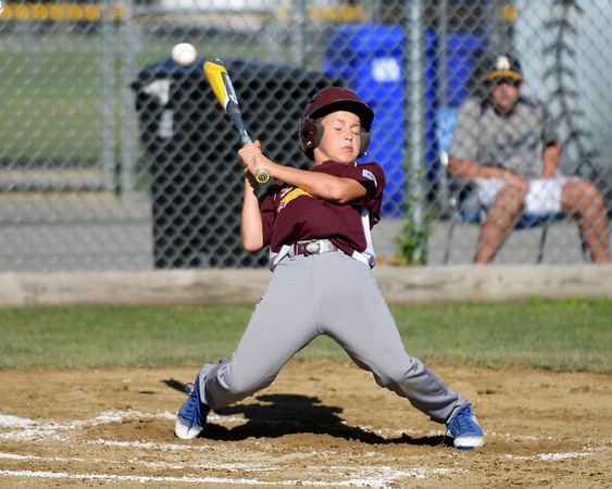 RYAN HUTTON/ Staff photo<br /> Danvers' Aithan Bezanson leans away from an inside pitch in the top of the second inning of Wednesday's Little League tournament game against Peabody West in Andover.