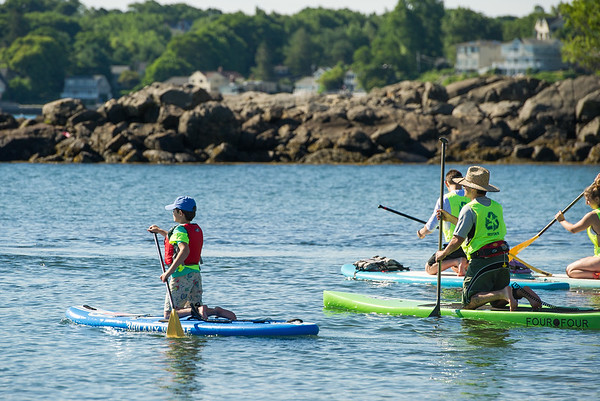 AMANDA SABGA/Staff photo<br /> <br /> People paddle out for a fun race during the 5th Annual Paddle for Plummer fundraiser for Plummer Youth Promise.<br /> <br /> 7/7/18