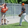 AMANDA SABGA/Staff photo<br /> <br /> Beverly's Ryder Frost (11) walks off the field defeated despite efforts to lift him up during a game against Amesbury at the Harry Ball Field in Beverly.<br /> <br /> 7/7/18