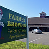 RYAN HUTTON/ Staff photo<br /> A car back out of a space at Farmer Brown's Farm Stand in Middleton Thursday without the occupant having gotten out. Farmer Brown's was closed on Thursday due to an apparent employee walk-out.