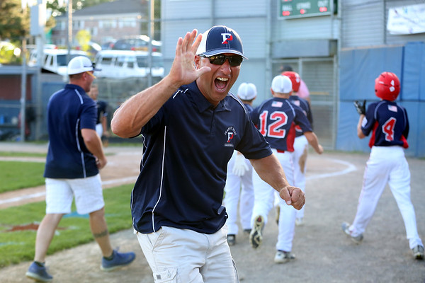 HADLEY GREEN/Staff photo<br /> Peabody West coach Lelo Fabbo reacts after his team wins against Lynnfield in the District 16 championship game at the Reinfuss Field in Lynn. <br /> <br /> 07/12/2018