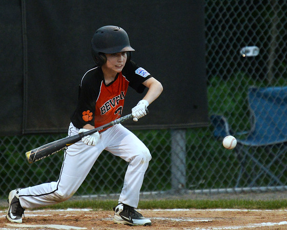 CARL RUSSO/staff photo. Beverly's Devin Koloski lays down the bunt. Beverly defeated Manchester Essex in Little League baseball action. 7/5/2018
