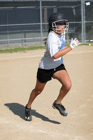 HADLEY GREEN/Staff photo<br /> Jessica Steed runs to first at the Peabody Little League softball practice at Cy Tenney Park. <br /> <br /> 07/11/2018