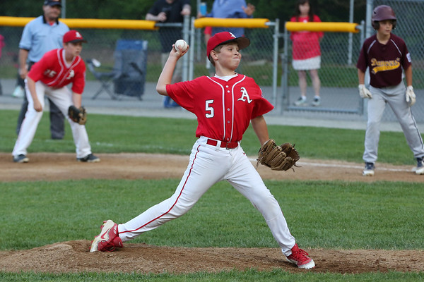 HADLEY GREEN/Staff photo<br /> Amesbury's Zack Hawrylciw (5) pitches at the Danvers National Little League all-stars vs. Amesbury District 15 championship game at the Harry Ball Field in Beverly. <br /> <br /> 07/13/2018