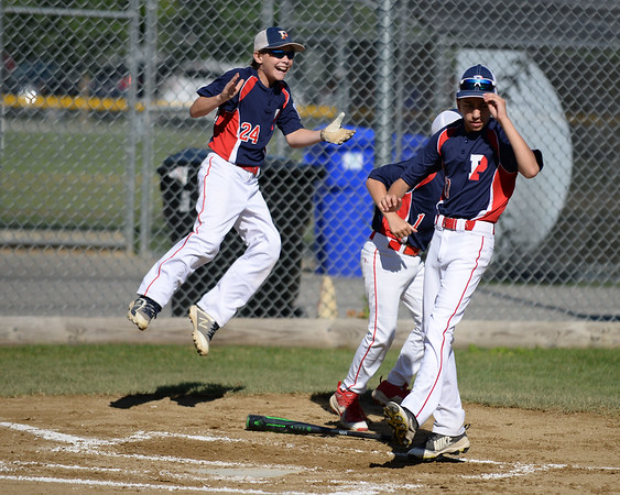 RYAN HUTTON/ Staff photo<br /> Peabody West players literally leap for joy as they rush to home plate to greet teammate Josh Scali as he rounds the bases after hitting a home run in the bottom of the first inning of Wednesday's Little League tournament game against Danvers in Andover.