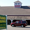 RYAN HUTTON/ Staff photo<br /> An SUV slowly drives through the parking lot of Farmer Brown's Farm Stand in Middleton before driving off on Thursday. Farmer Brown's was closed on Thursday due to an apparent employee walk-out.