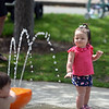 RYAN HUTTON/ Staff photo<br /> Shelby Mitchell, 16 months old, plays at the splash pad at the Beverly Homecoming in Lynch Park on Sunday.