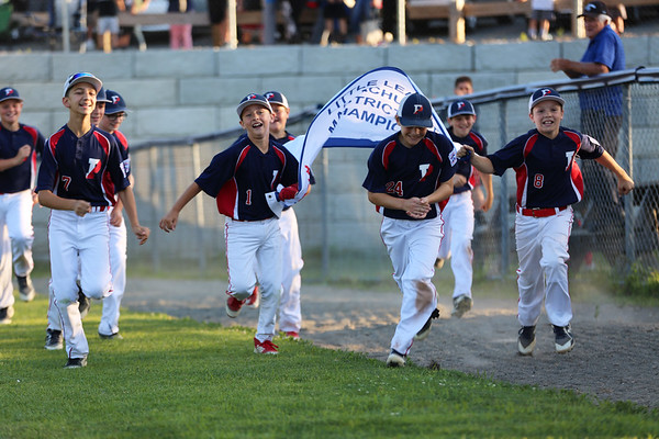 HADLEY GREEN/Staff photo<br /> Peabody West players run with the championship banner after winning the District 16 Little League final game against Lynnfield at the Reinfuss Field in Lynn. <br /> <br /> 07/12/2018
