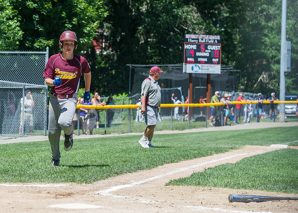 AMANDA SABGA/Staff photo<br /> <br /> Danvers National's Steven Reardon (15) runs to home plate during a game against Hamilton-Wenham at the Harry Ball Field in Beverly.<br /> <br /> 7/7/18