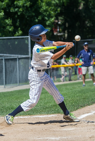 AMANDA SABGA/Staff photo<br /> <br /> Hamilton-Wenham's Andrew Green (9) hits the ball during a game against Danvers National at the Harry Ball Field in Beverly.<br /> <br /> 7/7/18