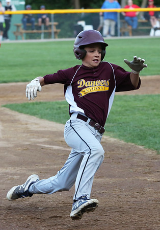 HADLEY GREEN/Staff photo<br /> Danvers National Little League all-star Nick Lembo (10) runs to third base during the District 15 championship game against Amesbury at the Harry Ball Field in Beverly. <br /> <br /> 07/13/2018