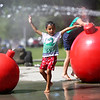 HADLEY GREEN/Staff photo<br /> K.C. McMurry, 4, of Beverly, runs through the splash pad at Lynch Park in Beverly.<br /> <br /> 07/12/2018