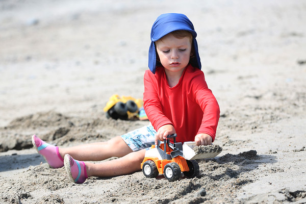 HADLEY GREEN/Staff photo<br /> Bowie Osborne, 2, of Marblehead, plays in the sand at Devereaux Beach in Marblehead. <br /> <br /> 07/31/2018