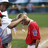 HADLEY GREEN/Staff photo<br /> Amesbury players receive their runner-up medals after losing to Danvers National all-stars at the District 15 championship game at the Harry Ball Field in Beverly. <br /> <br /> 07/13/2018