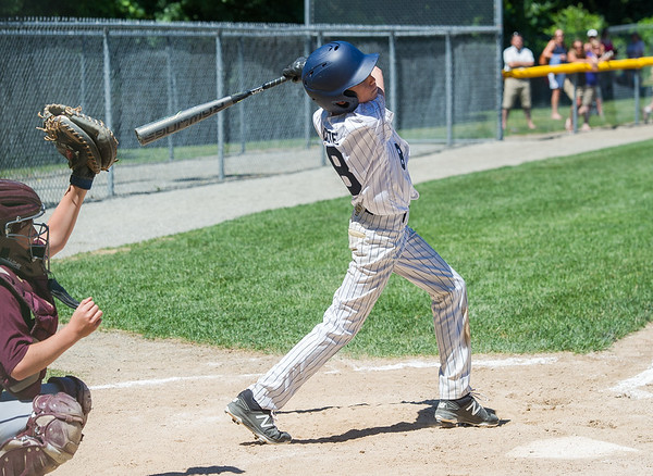 AMANDA SABGA/Staff photo<br /> <br /> Hamilton-Wenham's Aj Cote (8) swings and misses during a game against Danvers National at the Harry Ball Field in Beverly.<br /> <br /> 7/7/18