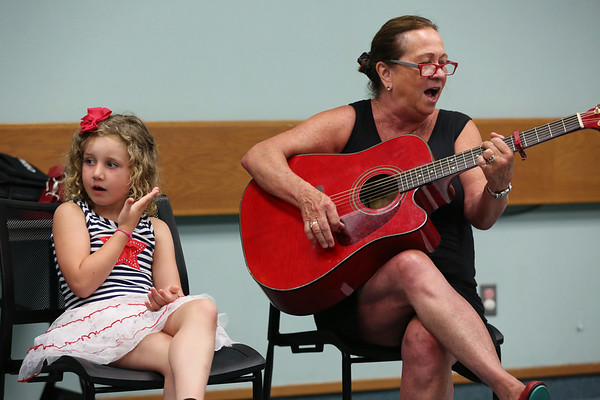 HADLEY GREEN/Staff photo<br /> Wendy Manninen, right, sings with her granddaughter Maya Holden, 6, during the Singing and Signing event at the Sawyer Free Library. Manninen, of Gloucester, leads the ASL sing along with Vicki Marsh of Manchester.<br /> <br /> 07/05/2018