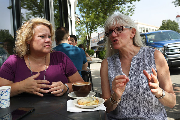 HADLEY GREEN/Staff photo<br /> From left, Kim Woods and Therese Melden talk about their new nonpartisan group, We are America the Beautiful, which was formed to increase local voter engagement. <br /> <br /> 07/24/2018