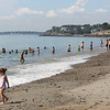HADLEY GREEN/Staff photo<br /> People swim on a hot July morning at Devereaux Beach in Marblehead. <br /> <br /> 07/31/2018