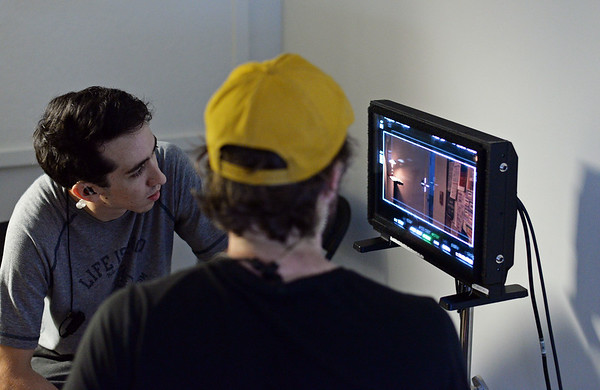 "RYAN HUTTON/ Staff photo<br /> Crew members of the film ""Selah and the Spades"" watch the shooting of a scene in a tight hallway at The Academy at Penguin Hall in Wenham on Wednesday."