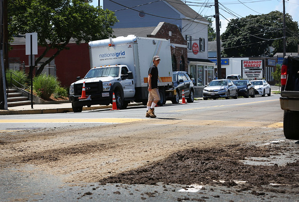 HADLEY GREEN/Staff photo<br /> Cars avoid manure dropped by a truck on Foster Street near Peabody Square on Tuesday afternoon. <br /> <br /> 07/24/2018