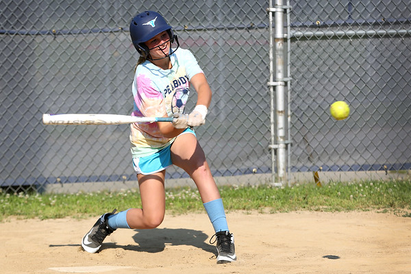 HADLEY GREEN/Staff photo<br /> Penelope Spack lines up her swing at the Peabody Little League softball practice at Cy Tenney Park. <br /> <br /> 07/11/2018