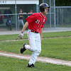 HADLEY GREEN/Staff photo<br /> Amesbury's Trevor Kimball (21) runs to first at the Danvers National Little League all-stars vs. Amesbury District 15 championship game at the Harry Ball Field in Beverly. <br /> <br /> 07/13/2018