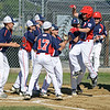 RYAN HUTTON/ Staff photo<br /> Peabody West's Josh Scali leaps on to home plate surrounded by his teammates after hitting a home run in the bottom of the first inning of Wednesday's Little League tournament game against Danvers in Andover.