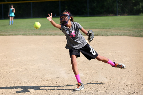 HADLEY GREEN/Staff photo<br /> Hailey Roach throws the ball to first at the Peabody Little League softball practice at Cy Tenney Park. <br /> <br /> 07/11/2018