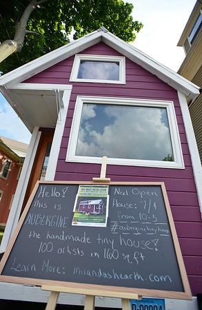 RYAN HUTTON/ Staff photo<br /> Sitting on Winter Street next to the Montserrat College of Art, Aubergine is a 1560 square foot tiny house built by artists and presented by Miranda's Hearth and Montserrat.