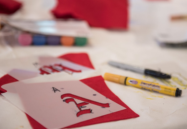 AMANDA SABGA/Staff photo<br /> <br /> Guests make their own scarlet letters during a marathon reading of Nathaniel Hawthorne's The Scarlet Letter at St. Joseph Hall in Salem, hosted by the House of the Seven Gables and the National Parks Service.<br /> <br /> 7/7/18