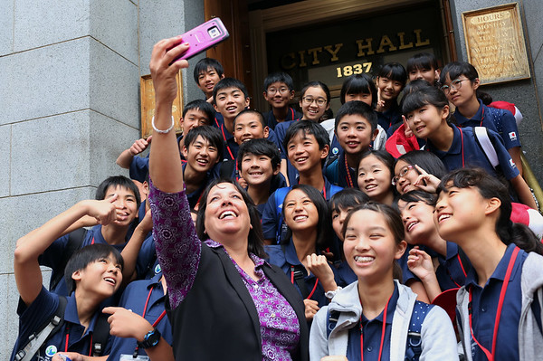 HADLEY GREEN/Staff photo<br /> Salem Mayor Kim Driscoll takes a selfie with middle school students from Ota, Japan who are visiting Salem as part of the sister city exchange tradition. <br /> <br /> 07/26/2018