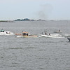 RYAN HUTTON/ Staff photo<br /> A trio of lobster boats speed past the Beverly harbormaster boat as seen from Lynch Park during the annual Lobster boat races on Sunday.
