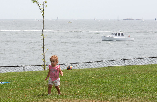 RYAN HUTTON/ Staff photo<br /> Valentina Minete, 1, plays in the grass at the Beverly Homecoming in Lynch Park on Sunday.