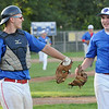 TIM JEAN/Staff photo<br /> <br /> Middleton/Peabody's catcher Trevor Lodi and pitcher Eddie Campbell celebrate getting out of the inning against Andover during an American Legion baseball game. Andover defeated Middleton/Peabody 1-0.  7/23/18