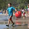 HADLEY GREEN/Staff photo<br /> Bryce Callahan of Wilmington cools off at the Lynch Park splash pad in Beverly.<br /> <br /> 07/12/2018