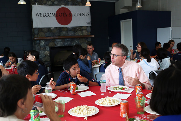 HADLEY GREEN/Staff photo<br /> Tom Daniels, director of planning and community development in Salem, speaks to students from Ota, Japan at a pizza party hosted by Mayor Kim Driscoll at Winter Island in Salem. <br /> <br /> 07/26/2018