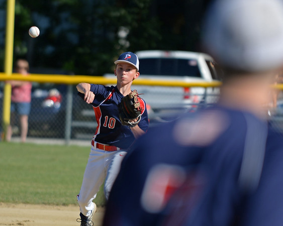 RYAN HUTTON/ Staff photo<br /> Peabody West's Thomas Fabbo fires the ball to first to try to make the out in the top of the second inning of Wednesday's Little League tournament game against Danvers in Andover.