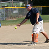 HADLEY GREEN/Staff photo<br /> Coach Mark Bettencourt pitches to his team during the Peabody Little League softball practice at Cy Tenney Park. <br /> <br /> 07/11/2018