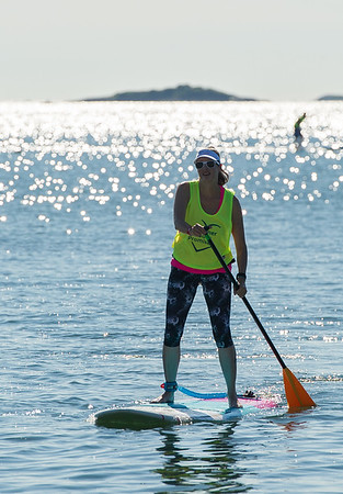 AMANDA SABGA/Staff photo<br /> <br /> A paddle boarder returns to shore during the 5th Annual Paddle for Plummer fundraiser for Plummer Youth Promise.<br /> <br /> 7/7/18