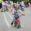HADLEY GREEN/Staff photo<br /> Jackson Lampert, 2, of Beverly, coasts through the obstacle course at the Bicycle Safety Rodeo at Lynch Park.<br /> <br /> 07/30/2018