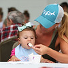 HADLEY GREEN/Staff photo<br /> Caty Gambale of Beverly feeds her daughter, Mia, at the Beverly Homecoming Ice Cream Social at Lynch Park.<br /> <br /> 07/30/2018