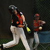 CARL RUSSO/staff photo. Beverly's Anthony Mastroianni swings hard for a base hit. Beverly defeated Manchester Essex in Little League baseball action. 7/5/2018