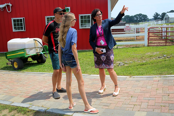 HADLEY GREEN/Staff photo<br /> Heidi Riccio, the new Essex Technical High School superintendent, points out the agricultural facilities to incoming freshman Alexis Grammas of Gloucester. <br /> <br /> 07/17/2018