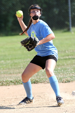 HADLEY GREEN/Staff photo<br /> Abby Bettencourt plays shortstop at the Peabody Little League softball practice at Cy Tenney Park. <br /> <br /> 07/11/2018