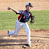 HADLEY GREEN/Staff photo<br /> Peabody West's Jayce Dooley (4) pitches against Lynnfield at the Little League District 16 championship game at the Reinfuss Field in Lynn. <br /> 07/12/2018