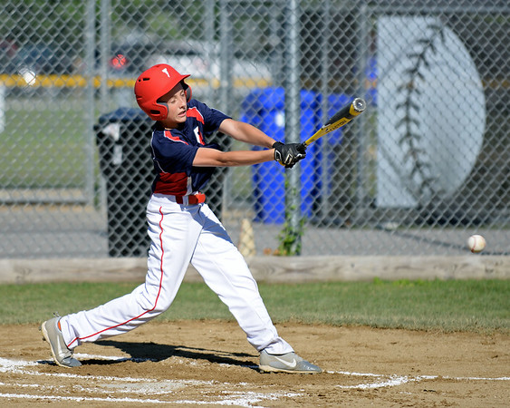 RYAN HUTTON/ Staff photo<br /> Peabody West's Jayce Dooley swings away at a pitch in the bottom of the first inning of Wednesday's Little League tournament game against Danvers in Andover.