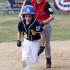 HADLEY GREEN/Staff photo<br /> Salem's Levy DaSilva (12) tags out Lynnfield's Nick Groussis (2) during a run-off between second and third base at the Lynnfield v. Salem Little League game at Pine Hill in Lynn.<br /> <br /> 07/10/2018